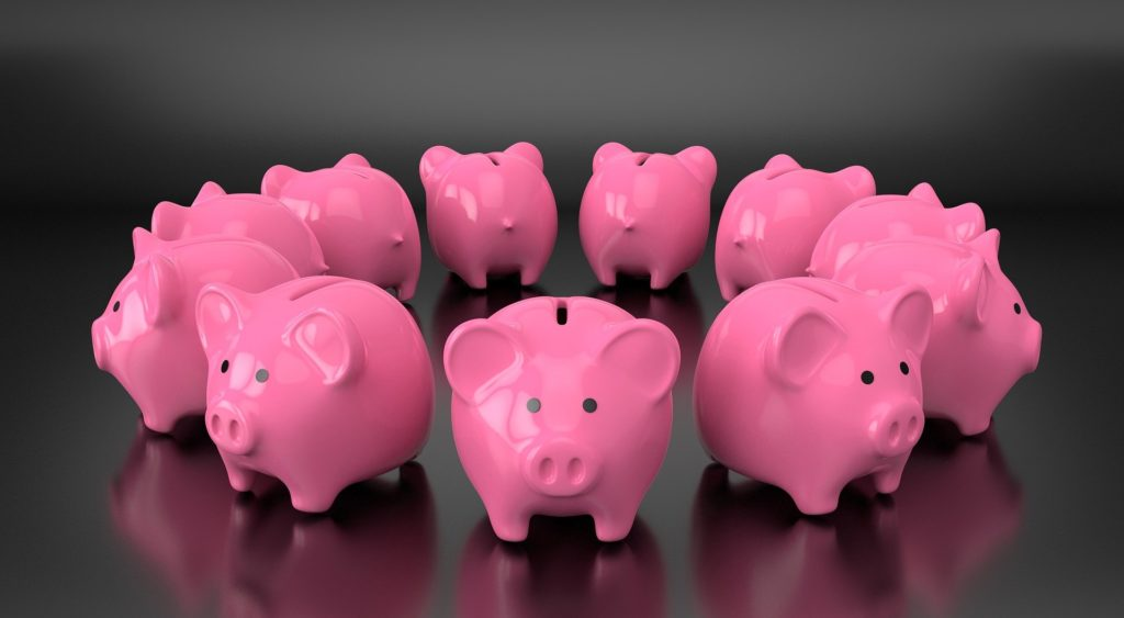 Circle of pink piggy banks